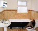Đề phòng điện giật khi tắm máy nước nóng
